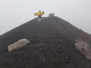 hiking up ridge of volcano to go volcano boarding