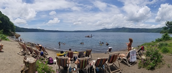 wide angle shot of Laguna de Apoyo lake in the volcanic crater